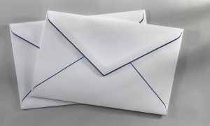 2 white envelopes with dark blue lining